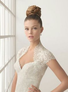 Like the lace shoulder part of this sweetheart wedding dress