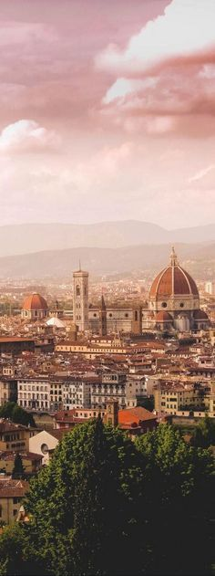 View from Piazzale Michelangelo ~ Florence, Italy ~ Piazzale Michelangelo (Michelangelo Square) is a square with a panoramic view of Florence, Italy, located in the Oltrarno (other side of the river) district of the city. This Florentine piazza was designed by architect Giuseppe Poggi and built in 1869 on a hill just south of the historic center.