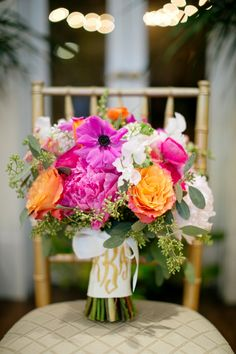 Pink and orange bouquet with a monogrammed ribbon