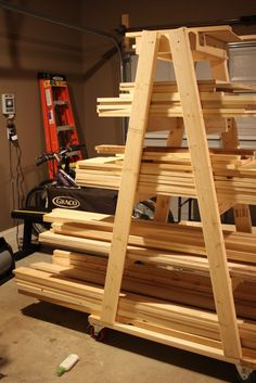 20 scrap wood storage holders you can diy wood storage for Mobile lumber storage rack plans