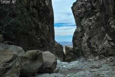"""Looking out through """"The Window"""" Chisos Mountain Basin, Big Bend National Park, Texas. Photography by Tim Speer"""