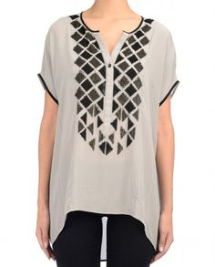 Attracted to this casual fancy top with some character. Not too sure about the colour being described as gray.   Fossil gray low high top with short sleeves featuring sequins work in geometric motifs. Round neck with button placket.