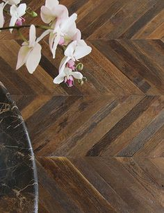 Cool. Reclaimed flooring in a Chevron that is left un-sanded and finished. Like it.