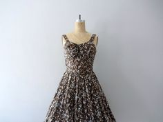 1950s sundress . vintage 50s dress . brown print dress by BlueFennel on Etsy https://www.etsy.com/listing/202723412/1950s-sundress-vintage-50s-dress-brown