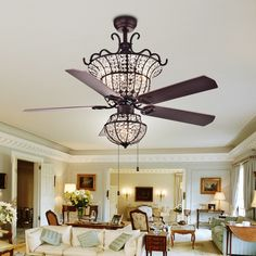 This is a glamorous and elegant ceiling fan for your home. The combination of antique bronze, crystals and wood makes a sophisticated statement in your living room. Selectable light combinations with