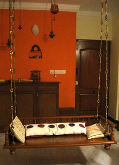 orange wall India Home Decor, Ethnic Home Decor, Decorating Blogs, Interior Decorating, Room Swing, Indian Home Interior, Wooden Swings, House Plants Decor, Shop Interiors