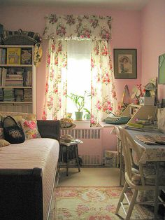 looks like my room growing up :)  I wouldn't like the pink walls, but I love all the pillows and nick nacks!