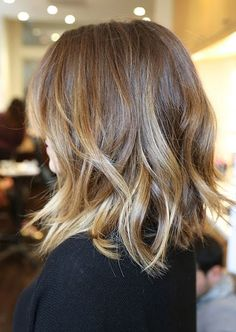 Girls with medium-length hair can get sexy waves, too. Just use a clampless waving iron to create loose texture.
