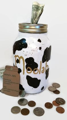 Cow Print Piggy Bank is a perfect and cute way to teach your little ones how to save money and patience. It can be used as a wonderful and fun learning tool!  But this bank isnt just for kids! Adults can use it too! Save up for that concert youve always wanted to go to, or for that road trip youve been thinking about! The quart sized jar is painted the typical black and white cow print with Moolah pained in gold. Its then sprayed down with a protective clear coat with gold glitter.   This…