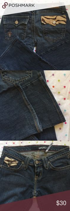 """Cello Jeans Cello in LA jeans. Super cute jeans with brown zebra print hide on pocket both in back and in front. Excellent used condition. Dark wash. 30"""" inseam Cello Jeans Boot Cut"""