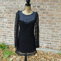 """Alice Ritter Victorian Inspired Black lace Dress Alice ritter Victorian inspired black satin and lace dress. Long lace sleeves with button cuffs. Excellent condition. Medium fit. Zipper closure . Measurements : Length 33""""  15"""" across front laying flat #ravenkittystyle #lace #lolita #goth #victorian #aliceritter #classic #steampunk #era #unique #blacklace #medium Alice + Olivia Dresses Mini"""