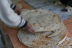Freshly baked discs of crispbread, Yazd, Iran