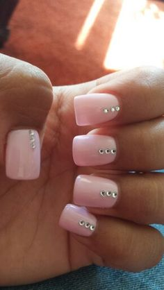 "Pink gel nails! I like the 3 ""diamonds"" on them"