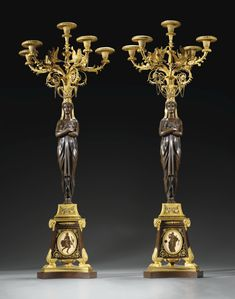 A PAIR OF PATINATED, GILTBRONZE AND HARD PASTE PORCELAIN EGYPTIAN FEMALE CANDELABRA, LATE LOUIS XVI, CIRCA 1790-1795, THE BRONZE ATTRIBUTED TO PIERRE-PHILIPPE THOMIRE, THE DECORATION OF THE PORCELAIN TO PIAT-JOSEPH SAUVAGE