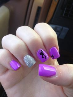 Cute purple nails with a cross and a browning sign! :) in love with my nails