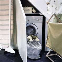 Clever use of space - Under-stair laundry cupboard