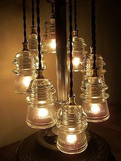 30 creative ways of reusing old vintage glass insulators for Glass electric insulator crafts