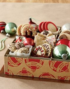 Vintage Ornament and Cookie Container...cookies interspersed with Christmas balls and arranged in a vintage ornament container