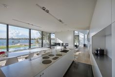 Do you love all-white interiors? This Netherlands home features aMassive Contemporary Residence Taking in Perfect Lake Views. From the glass to the finishes, we think it's very sophisticated & modern! #interiors #contemporary #modern #ideas http://bit.ly/1ucuXiq