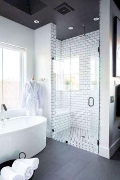 Beautiful Master Bathroom Remodel Ideas, subway tile shower, free standing tub, black floors, modern bathroom