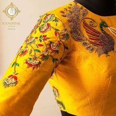 Stunning yellow color designer blouse with peacock design hand embroidery thread and zardosi work on yoke. Floret lata design hand embroidery green and red color thread and zardosi work on sleeve.    09 May 2018