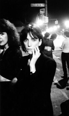 Patti Smith, one of the first artists booked to play the club when it opened, arriving (1976). | 17 Awesome Photos That Captured CBGB's Iconic 1970s Punk Scene