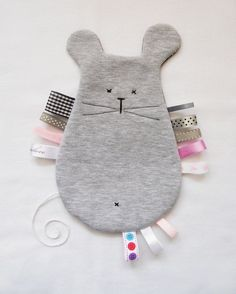 GRAY MOUSE – cuddly toy, teether with tags (mirelove design), available for purchase at DecoBazaar. Baby Sewing Projects, Sewing For Kids, Handmade Baby, Handmade Toys, Sewing Toys, Sewing Crafts, Diy Bebe, Baby Couture, Fabric Toys