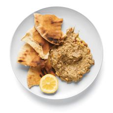 Baba Ghanouj  Grill whole eggplants, turning occasionally, until blackened and collapsed, 20 to 30 minutes. Cool, peel and mash; combine with 1/2 cup toasted pine nuts, 1/3 cup tahini or yogurt, olive oil, lemon juice and minced garlic. Serve with pita.