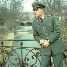 ♡♥Elvis Presley relaxes on a bridge as a private in the army♥♡