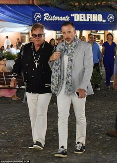 Dinner date: Elton John, 69, and husband David Furnish, 53, stepped out for dinner in Portofino, Italy, on Friday night