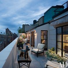 """The lovely terrace overlooks Park Avenue,"" Allem says of the 380-square-foot space. ""It connects to the family room and offers an outdoor area for family gatherings."" The poodle sculpture is by Bencomo. Chairs and tables, Restoration Hardware 