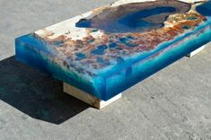 """Furniture designer Alexandre Chapelin wows us with this new pair of tables that mimic a cross-section of an underwater reef. The Saint Martin-based artist uses natural stone encased in a translucent blue resin to """"bring the ocean into your living room. Resin Furniture, Garden Furniture, Furniture Design, Resin Crafts, Resin Art, Wood Resin Table, Wood Tables, Wood Pieces, Natural Stones"""