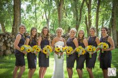 bridal party photography // love the sunflowers and black dresses!