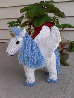 Beautiful Blue and White Winged Unicorn - Handmade Crochet Plush Toy Pony - Made to Order. $35.00, via Etsy.