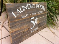 Vintage Rustic Laundry Sign for the Laundry room. Bring a bit of old time vintage charm to your otherwise boring laundry room. Spice it up a bit and enjoy looking around while folding those unmentionables! ($75)