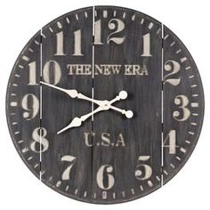 Planked wood wall clock.    Product: Wall clockConstruction Material: WoodColor: Black and whiteAccommodates: (1) AA battery - not includedDimensions: 28.5 Diameter