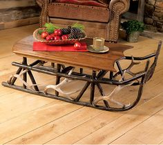 Rustic cabin living room decor with hickory and antler rustic sleigh table. #cabinlife