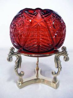 Fenton ruby glass candle bowl with brass stand.