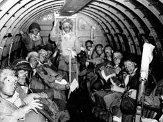 JUN 6 1944 0230: 82nd Airborne fly into the cloud bank US paratroopers on board their C-47 about to depart.