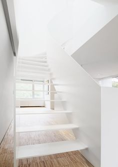 cool stairs. white + wood!