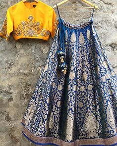 Bright yellow blouse with contrasting blue lehenga by Jayanti Reddy