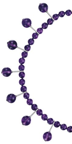 MARGHERITA BURGENER An Amethyst and Diamond Necklace  Designed as an amethyst bead line, the front suspending seven pavé-set diamond links with amethyst bead terminals, mounted in 18K white gold, length 18 inches. Signed 'MB', 'Margherita Burgener', with a Margherita Burgener box