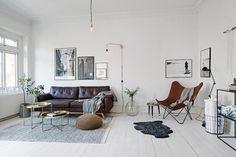 Dark leather on a light floor - via cocolapinedesign.com