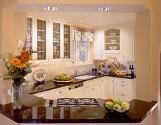 Home Improvement Ideas - White Kitchen Cabinets with Glass Doors