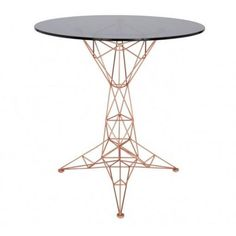 Inspired by bridges, towers and space frames, the Pylon collection is made of semi-transparent and lightweight pieces. Available as a dining table, coffee table, small table and a coat stand. The Pylon Side Table features a beautiful charcoal coloured glass table top. Material: Copper Plated Steel and Glass  Dimensions: Diameter 65cm x H 70cm