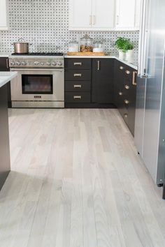 Used throughout the house, the bleached and faded hardwood floors bring a lightness to the rooms including the kitchen.