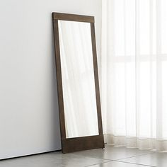 Shop Colby Bronze Floor Mirror.  Architectural modern mirror leans against the wall with attitude in a sleek, asymmetrical stainless steel frame finished in warm bronze.