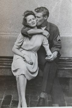 Early post WW2 photograph of US Army Sgt kissing a German girl