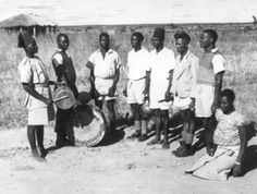 Mozabique. Muganda dance with malipenga singing gourds, large muganda drum and smaller chandi drum. Photograph by Hugh Tracey. Courtesy of the International Library of African Music.