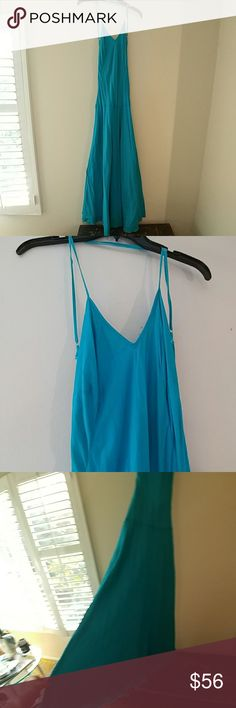 Sexy. Backless sundress Color is more turquoise than in photo..straps cross in back and are adjustable..flowing at bottom which makes your both look curvy and lean unknown Dresses Maxi